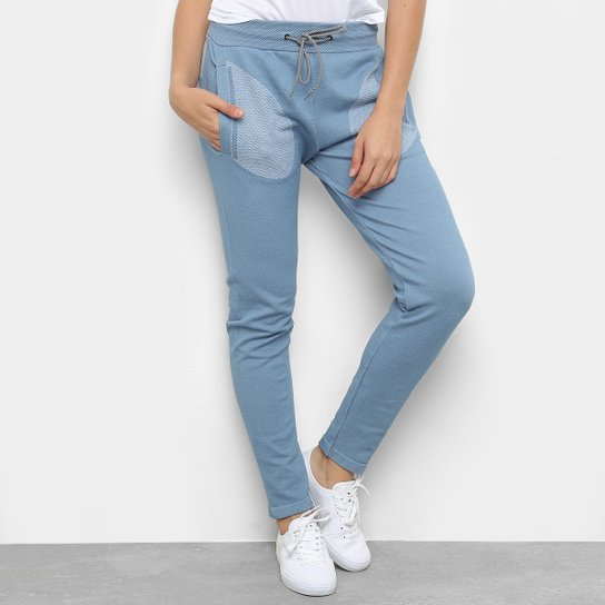 83dd5f355 Calça Moletom Asics Bolso Estampado Premium Knit Feminina - Azul ...