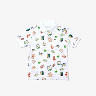 Polo infantil Lacoste em piqué de algodão com emblemas estampados